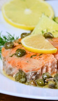 Slow cooker poached salmon steaks recipe. Fresh salmon steaks with onion and dry white wine cooked in a slow cooker and served with yummy homemade lemon-caper sauce. #slowcooker #crockpot #salmon #seafood #dinner Salmon Steak Recipes, Poached Salmon, Steaks, Crockpot Recipes, Crock Pot, Slow Cooker, Lemon Caper Sauce, Recipe Magic, Cake Recipes From Scratch