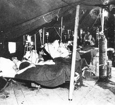 Army nurses at work in the postoperative ward, U.S. Army 10th Field Hospital, Grandvillers, France, 1944.