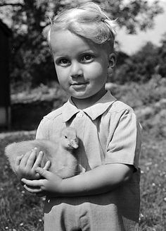 """Cute little boy and his gosling. So adorable... Wales, June 16, 1950, by photog Geoff Charles. [Welsh title: """"Y cyw gŵydd dof"""" (hello)] This boy would be 65 today! And here I am pinning a photo of him. :)"""