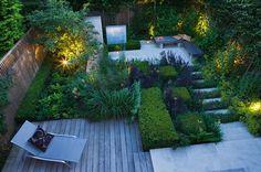 Reflection Garden | Garden lit up at night | Charlotte Rowe Garden Design