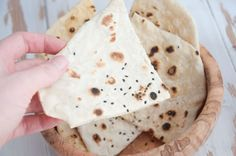 Recipe for a vegan, oil-free, 4 Ingredient Sesame Naan. It only takes 3 minutes to make and is the perfect addition to any curries or other indian dishes.