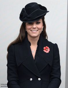 Catherine, Duchess of Cambridge, aka Kate Middleton, watches Remembrance Sunday events at the Cenotaph in London. Kate is wearing the Flared Wool Coat from Alexander McQueen, Tuxedo Trim Matte Jersey Dress by BCBGMAXAZRIA, hat by Jane Corbett, and her sapphire and diamond earrings, with her  'Empress' necklace by jewelers Mappin and Webb. 11/09/14