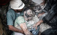 Search and rescue teams remove a body from the rubble after the Syrian regime shelled an opposition-controlled area of Aleppo on Aug. 14, 2014. AHMED MUHAMMED ALI/ANADOLU AGENCY/GETTY IMAGES