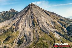 Colima's southwestern slope with numerous andesite lava flows snaking down. Nevado de Colima peak in the left background