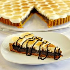 S'mores Tart, for Anna who was looking for a kid-friendly dessert for her upcoming weekend get-together. Just try keeping the adults away from it! A luscious chocolate and marshmallow tart with a graham cracker crumb crust that celebrates the much loved campfire treat.
