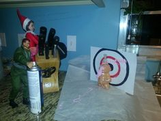 GI Joe and Sarah the Elf are ganging up on the gingerbread man.