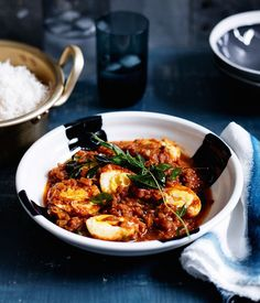 Fast Indian-style curried eggs with rice recipe :: Gourmet Traveller