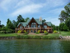 I want a log cabin house soooo bad. Doesn't have to be this big but it does have to be on a lake =)