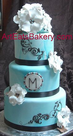 Blue marbled fondant wedding cake with sugar flowers and pearls