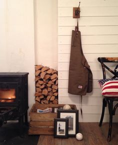 Wood burner and apron on a white wall