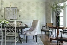 CHATHAM, NJ | VALERIE GRANT INTERIORS - Dining room ideas for mixing dining table side chairs and end chairs. Neutral tones and subtle greens are the palate for this gracious gathering spot. #diningroomdesign #diningroomchairs #neutral #rattanchairs