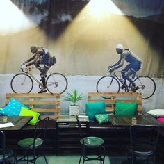 Bay Ten Espresso cafe bike repair shop and sports massage studio occupies a warehouse under the arches of Sydney Harbour Bridge in Lavender Bay. This huge photo mural depicts a classic Tour de France battle. @baytenespresso #bay10espresso #baytenespresso #sydneyharbourbridge #cafe #bikes #interiors #lavenderbay #sydney #designfizz by thedesignfizz http://ift.tt/1NRMbNv
