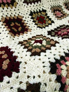 Granny Blanket by Wool n Hook, via Flickr Love the muted earth tones and the snowy white together.
