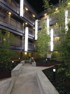 The courtyard provides a place of sanctuary for the special-needs residents. Floating light fixtures add to the contemplative, otherworldly feeling.