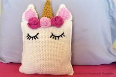 This sweet Unicorn Pillow Friend Crochet Pattern is the perfect huggable size and looks so pretty sitting on a bed or shelf. It's a great amigurumi beginner project #UnicornPillow
