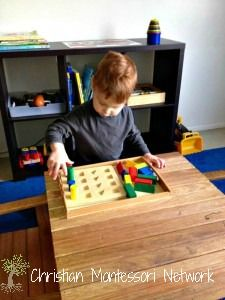 Low shelves and baskets are great for setting up a Montessori infant home. www.christianmontessorinetwork.com