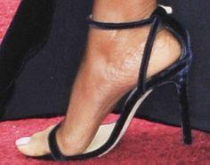 Taraji's foot jumps on the velvet train in a classic pair of Jimmy Choo Minny sandals