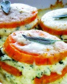 butternut squash lasagna in mini form, individually portioned. Round slices of butternut squash are layered in with a creamy ricotta mixture and topped off with a sage, garlic and parmesan infused bechamel.