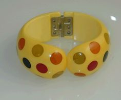 Bakelite Multi Dot Hinged Bracelet .  Authentic Bakelite Jewelry designed by Jorge Caicedo Montes de Oca. NY.NY.  Ivory color comb with multi colors dots .