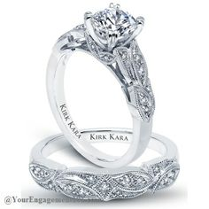 I love love love this! By far, my favorite!  Kirk Kara Dahlia engagement ring with matching wedding band.