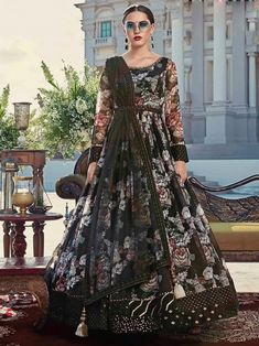 Endearing black embroidered gown online at best shopping price. Shop this latest gown style for diwali celebration. This alluring style set comprises a cotton gown with matching net dupatta.