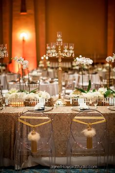 Gold and white table decor with orchids at Fox Theater Wedding Reception