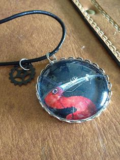 FREE US SHIPPING - Steampunk bird photo pendant with watch gear charm via Etsy