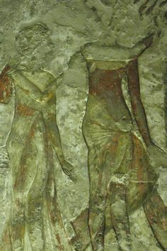 Akhenaten's yellow ochre loincloth looks gilded. The red belt, which he wears under the belly in the front, and high above the waist in the back, whereas Nefertiti wears hers over the belly, is much larger than it was for other dynasties. His dark brown torso is bare, except for the Ousakh broad collar. 18 th dynasty, tomb of MeryRe. Amarna/Akhetaten.