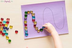 Tracing lines with buttons or gems fine motor activity for preschool.