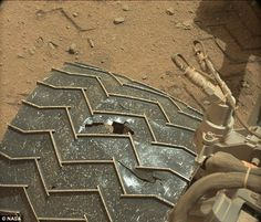 In 2014 a large hole was spotted (shown) in the middle-right wheel of Nasa's Curiosity rover on Mars