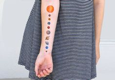 This one piece temporary tattoo features all nine planets (including pluto!) and the solar systems greatest star: the sun. ♥ Package includes 1 piece ♥ Packaged in plastic, shipped in a rigid mailer ♥ Will last approximately 2-5 days ♥ Non-toxic & safe  Application: 1) Feel free to trim your tattoo closer to the image for an even more realistic look. 2) Before applying, make sure skin is clean, dry and free of oils. 3) Remove the clear plastic top sheet and apply the tattoo to your skin…