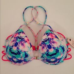 """NWT Victoria's Secret """"Fabulous"""" Push Up Swim Top Brand New With Tag.  Victoria's Secret Push Up Swim Top.  Front Hook Closure.  Gold-Toned Shiny Hardware.  Underwire.  Molded Built-In Push Up Padding.  This pretty strappy push up is called """"The Fabulous""""  Colors: blue, white, turquoise, neon pink straps, & a touch of yellow.  Retail value $48.50 + tax (Approx $52) Top-Rated Seller.  Fast Shipper!  Thanks for Looking No Trades No Off-Site Selling Victoria's Secret Swim Bikinis"""