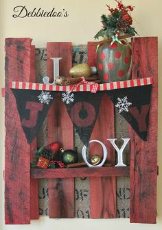 JOY: mini burlap banner Christmas craft: Use grocery bags, die cut letters, and wrapping paper to decorate
