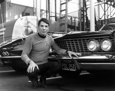 Leonard Nimoy posing in front of his 1964 Buick Riviera with the back end of William Shatner's 1963 Corvette Stingray.