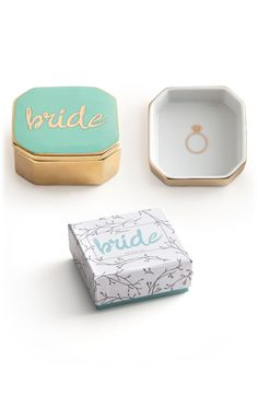 Commemorating the big day with this porcelain trinket box in gold and turquoise that's perfectly sized for the safekeeping of the most important wedding-day accessory.