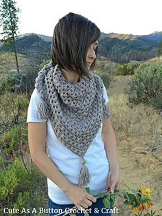 This version of the half granny square triangle scarf uses alternating Double Crochet and Extended Bobble Stitch rows to create a more 3 dimensional texture. The result is a warm, cozy shawl with eye-catching depth. Finishing off with some chunky tassels makes it a great statement piece for any fall or winter outfit!