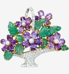 A Multi-Gem and Gold Floral Basket Brooch Composed of amethysts and cultured pearl flower blossoms amid carved emerald leaves, the basket and handle decorated with round and baguette-cut diamonds, mounted in 18k white and yellow gold: