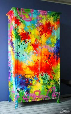 Wish I had the moxie to do this to one piece of furniture, in my home.  Colorful!