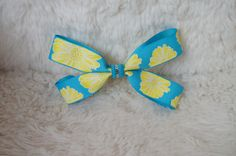 Turquoise and Yellow Flower Grosgrain Bow with a fun Turquoise and Shiny Silver Center Ribbon via Etsy