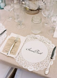 I love the doilies as place markers.  If you didn't want to put names on them, you could buy a monogram stamp.