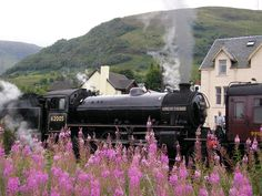 Steam train at Fort William,  the second largest settlement in the highlands of Scotland.  The town lies at the southern end of the Great Glen, on the shores of Loch Linnhe and Loch Eil and is close to Ben Nevis, the highest mountain in the British Isles.