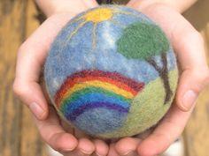 felted wool story ball, rainbow scene with sheep, sun, creek, trees