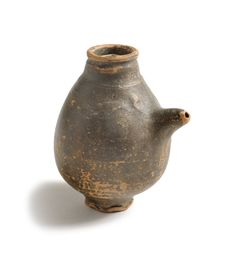 Roman feeding bottle made of fine red ware with a dark brown coating. Roman Archaeology Collection, Colchester.