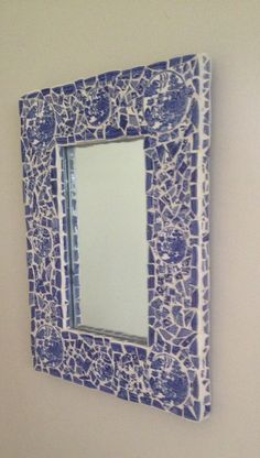 Mosaic mirror made with broken pieces of Blue Willow china