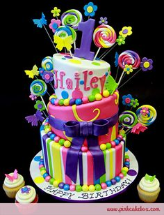 Topsy Turvy Candy Cake 1st Birthday Cake by Pink Cake Box in Denville, NJ. More photos and videos at http://blog.pinkcakebox.com/topsy-turvy-candy-cake-1st-birthday-cake-2010-12-15.htm