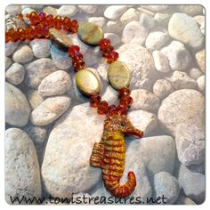 Custom handmade one of a kind necklace Amber crystals  natural Jasper gemstones and the seahorse is paper Mâché made by a local artist painted to coordinate with colors of beads Toni's Treasures  Jewelry Necklaces