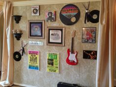 Rock and Roll photo backdrop: the framed album covers opened up on hinged doors so guests could peek their faces through the frames from behind the wall.  Most of the people posed in front of the wall with real instruments, microphones, and other party props.