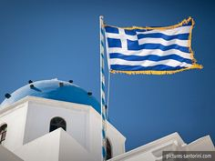 Flag of Greece next to Aigios Stratis in Imerovigli, Santorini. Flag Photo, White Building, Beautiful Dream, Beautiful Islands, Imerovigli Santorini, Greece, Blue And White, Waves, Greek Islands
