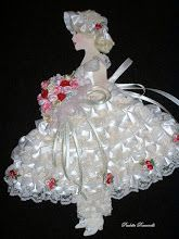 off white paper/ribbon doll.    My grandmother had these lovely ladies in ribbons and lace which very delicate and pretty.  They were quite old when she gave the to me, now nearly 100 years old.
