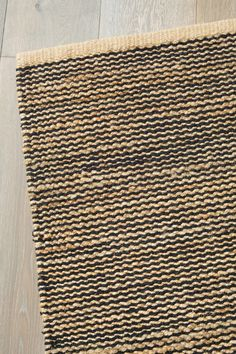 I love the idea of a warm rug over tiles or floorboards for the winter months (or all year round!) the Drift Weave in Natural/Black from Armadillo&Co does the trick perfectly.